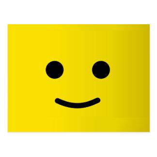 Cara sonriente feliz amarilla postal