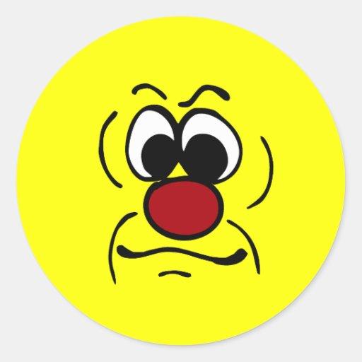Cara sonriente melancólica Grumpey Etiquetas Redondas