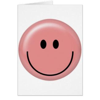 Cara sonriente rosada feliz tarjeta de felicitación