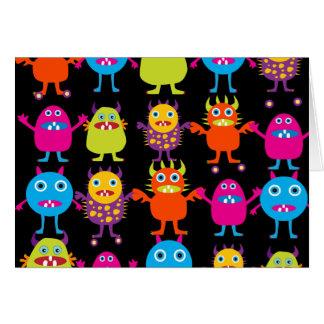 Caracteres coloridos divertidos de las criaturas tarjeta