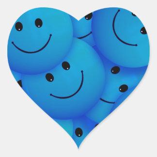 Caras sonrientes azules felices frescas de la pegatina corazon