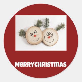 Caras sonrientes de madera de las Felices Navidad Pegatina Redonda
