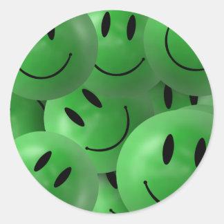 Caras sonrientes verdes felices frescas de la pegatina redonda