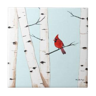 Cardenal con los árboles de abedul azulejo