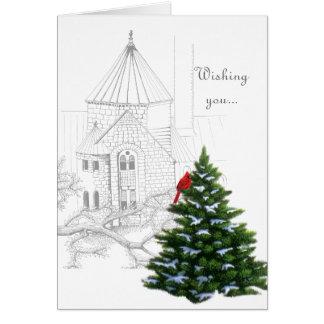 Cardenal que adorna el árbol de navidad de un tarjeta de felicitación