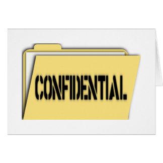 Carpeta confidencial con el papel tarjeta de felicitación