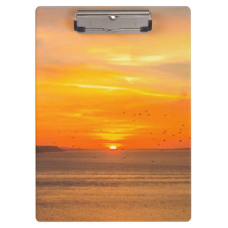 Carpeta De Pinza Costa de la puesta del sol con Sun anaranjado y