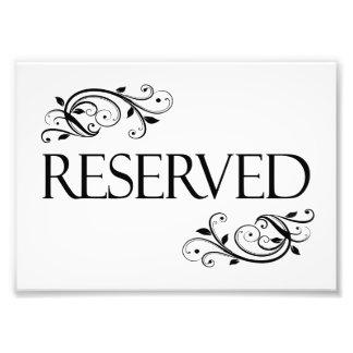 Casar la tarjeta reservada de la tabla fotografías