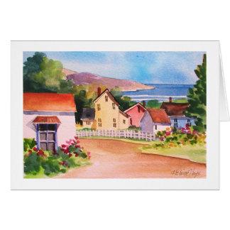 Casas del pueblo de la vista al mar tarjeta
