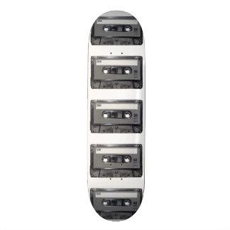 Casete gris de la etiqueta tabla de skate