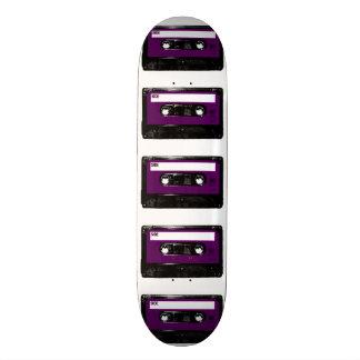 Casete púrpura de la etiqueta tabla de patinar