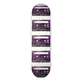 Casete púrpura y negro de la etiqueta de Houndstoo Tabla De Patinar