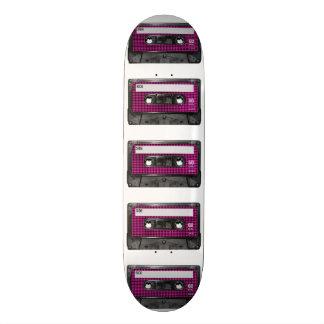 Casete rosado y negro de la etiqueta de Houndstoot Patines