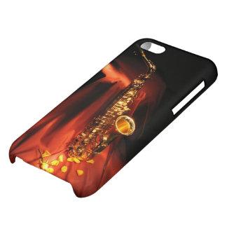 Caso brillante del iPhone 5C del saxofón rojo