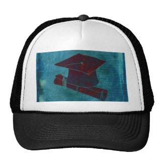 Casquillo de la graduación en el papel con la gorros