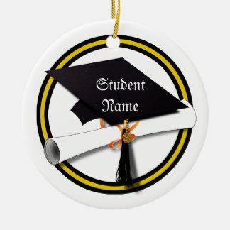 Casquillo del graduado y oro y negro del diploma ( ornamentos de reyes magos