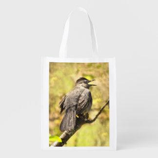 Catbird gris del canto bolsos de ultramarinos