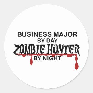 Cazador importante del zombi del negocio pegatina redonda
