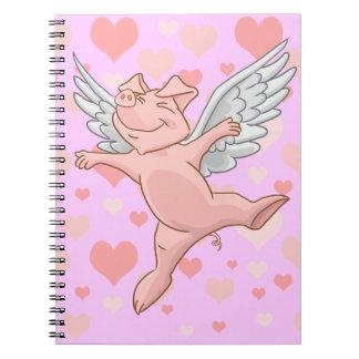 Cerdo del vuelo y libreta rosada de los corazones