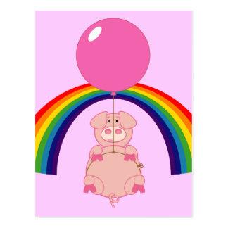 cerdo flotante del vuelo sobre el arco iris postal