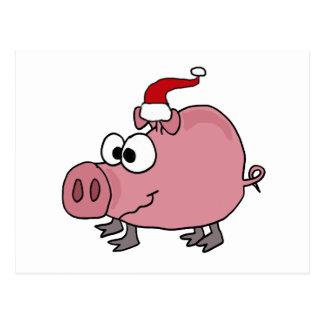 Cerdo rosado divertido en el gorra de Santa Postal