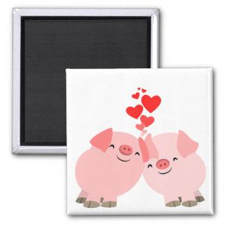Cerdos lindos del dibujo animado en imán del amor