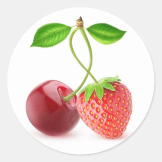 Cereza y fresa junto pegatina redonda