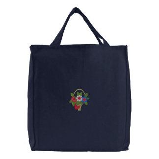Cesta blanca y azul roja de flores bolsas de mano bordadas