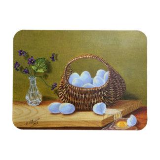 Cesta de huevos con las violetas imán flexible