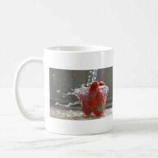 Chapoteo de la fresa taza