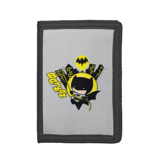 Chibi Batman que escala la ciudad