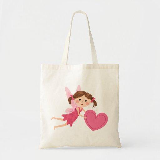 Chica de hadas del pequeño dibujo animado lindo co bolsas