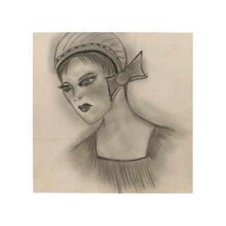 Chica de la aleta con el arco impresión en madera