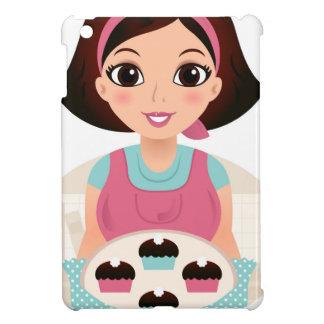 Chica de la cocina con las galletas