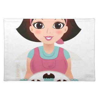 Chica de la cocina con las galletas salvamanteles