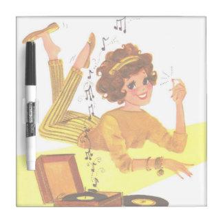 chica de la música de los años 60 tablero blanco