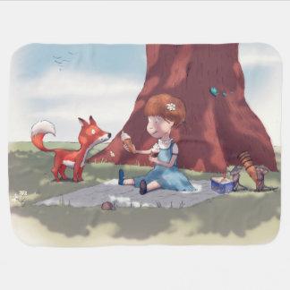 Chica del dibujo animado debajo del árbol manta de bebé