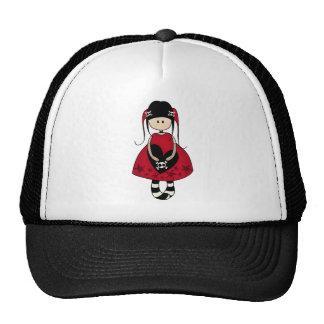 Chica del gótico en vestido rojo gorra