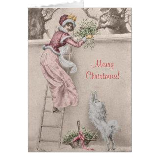Chica del vintage con navidad del muérdago y del tarjeta de felicitación