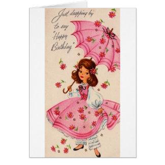 Chica del vintage en rosa con la tarjeta de cumple