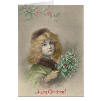Chica joven con navidad del acebo tarjeta de felicitación