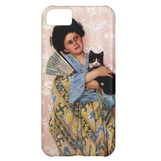 Chica oriental con un gato del mascota