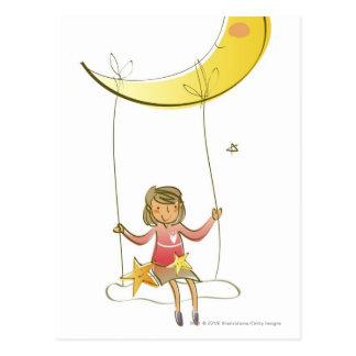 Chica que balancea en una cuerda que cuelga de la postal
