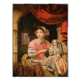 Chica que sostiene una muñeca en un interior postal