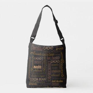 Chocolate, almendras y diseño oscuro del texto del bolso cruzado