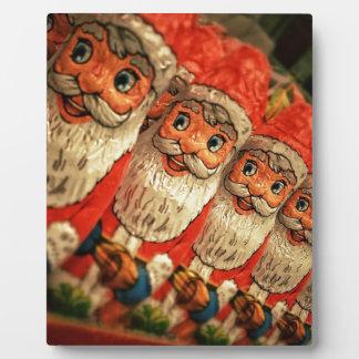Chocolate Santas en una fila, caramelo Placa Expositora