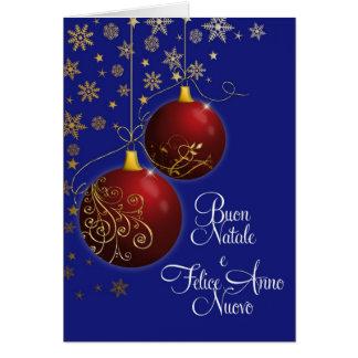 chucherías rojas del navidad con el saludo italian felicitacion