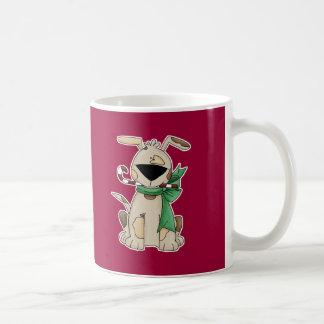 Chucho del navidad con el bastón de caramelo taza