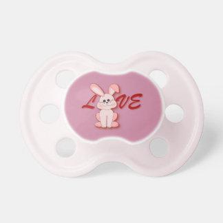 Chupete Conejo rosado feliz de la lupulización para el día