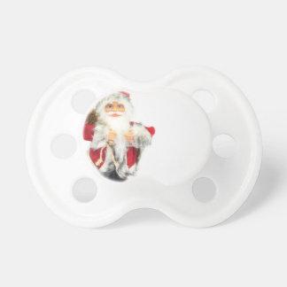 Chupete Estatuilla de Papá Noel aislada en el fondo blanco